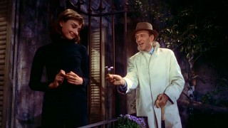 """Some flowers, mon amour?"" Fred Astaire tries to brighten Audrey Hepburn's wet night with some song and dance."