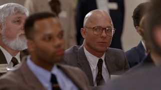 Bald, persistent FBI Agent Wayne Tarrance (Ed Harris) surprises Mitch with his unexpected appearance at a Washington conference.