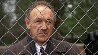 Veteran partner Avery Tolar (Gene Hackman, in his first of three Grisham movies) pays a visit to the school playground where his protege's wife is supervising recess and invites her to join him on his imminent business trip.