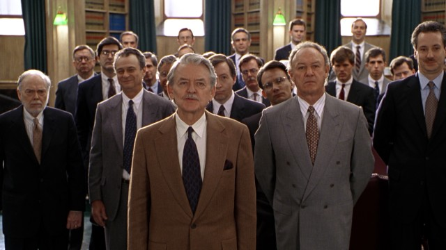 A few cracked smiles reveal that this gathering of the 41 lawyers of Memphis firm Berdini, Lambert & Locke, led by Lambert (Hal Holbrook), is not as serious and shady as it first seems.