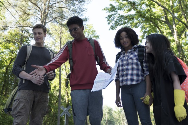 "The four young leads --  Liam (Harris Dickinson), Chubs (Skylan Brooks), Ruby (Amandla Stenberg), and Zu (Miya Cech) -- share a smile in  ""The Darkest Minds."""