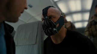 The bald, masked baddie Bane (Tom Hardy) is introduced early on as the film's primary villain.