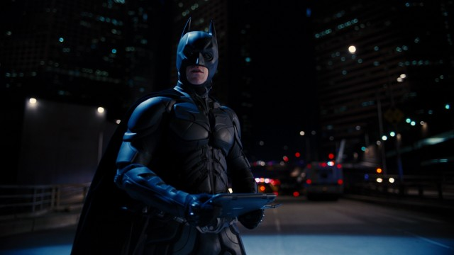 Batman is back, though he has a false reputation to live down, as Gotham's police pursue him.