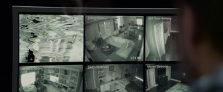 Scrambled home surveillance camera footage troublingly suggests an otherworldly intruder.