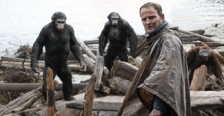The apes reluctantly allow Malcolm (Jason Clarke) to enter their camp to fix a dam.