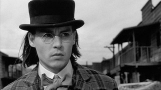 Bow-tied and bespectacled accountant Bill Blake (Johnny Depp) is surprised by the sights he walks past in the dusty western town of Machine.