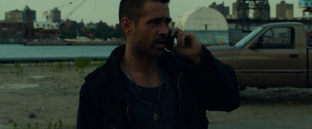 "Victor (Colin Farrell) gets a phone call, his big secret now out of the bag in ""Dead Man Down."""