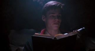 Neil Perry (Robert Sean Leonard) reads some poetry to The Dead Poets Society gathered in a cave.