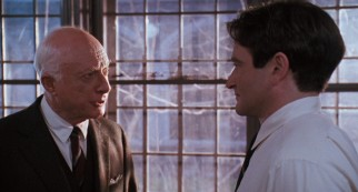 Welton headmaster Mr. Nolan (Norman Lloyd) gives Keating (Robin Williams) grief over what he has been teaching.