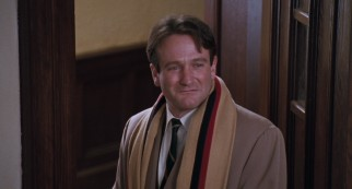 John Keating (Robin Williams) makes a heroic exit before his grateful pupils.