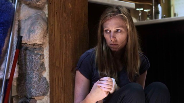 "In ""Dead Within"", trying to endure a zombie apocalypse takes a toll on Kim (Amy Cale Peterson)."