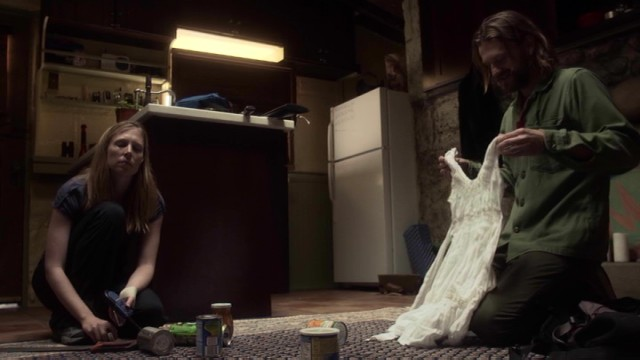Kim (Amy Cale Peterson) isn't as excited as Mike (Dean Chekvala) by the white dress he just found.