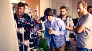 "A behind-the-scenes still from ""This is a Movie: Making (Dean)"" shows Demetri Martin acting directorial."