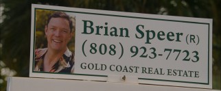 "Matthew Lillard makes his first appearance as realtor and ""other man"" Brian Speer on a bench advertisement."