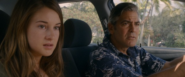 "On a father-daughter reconnaissance mission, Matt (George Clooney) and Alex (Shailene Woodley) get their first look at Brian Speer in bench advertisement form in #39, ""The Descendants."""