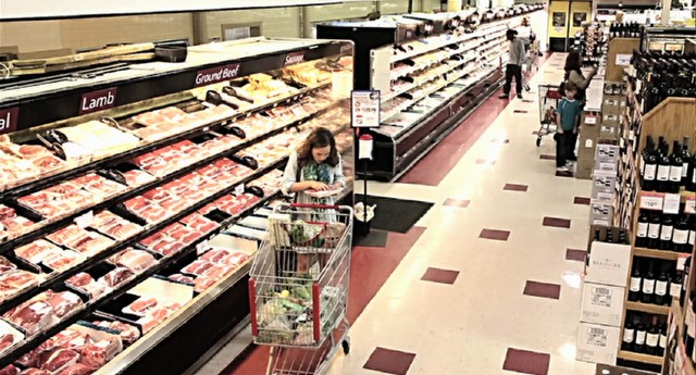 "Grocery store surveillance footage captures Samantha McCall's sudden craving for raw meat in ""Devil's Due."""