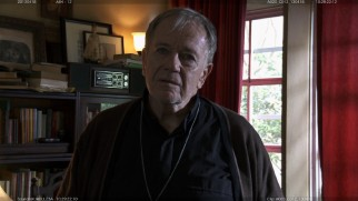 Sam Anderson appears as Father Thomas in this deleted scene.