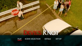 A mourner falls at the crime scene on the Devil's Knot DVD main menu.