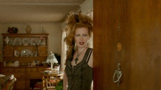 Vicki Hutcheson (Mireille Enos) welcomes you to a satanic gathering.