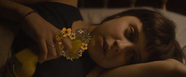 An animated heart made of flowers forms around the telephone for Minnie Goetz (Bel Powley).