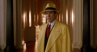 Warren Beatty dons a yellow fedora and trench coat as comic strip detective Dick Tracy.