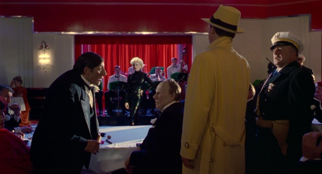 Dick Tracy (Warren Beatty) and fellow cops crash Big Boy's (Al Pacino) club during a Breathless Mahoney (Madonna) performance.