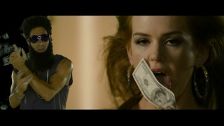 "Isla Fisher gets to lick money and dance in Aladeen's (her husband Sacha Baron Cohen) music video for ""Your Money Is On the Dresser."""