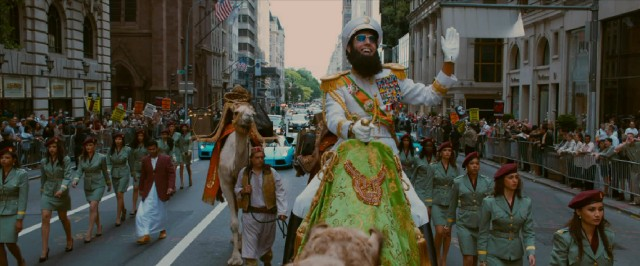 Wadiyan dictator Admiral General Aladeen (Sacha Baron Cohen) proudly rides down a Manhattan street on the back of a camel.