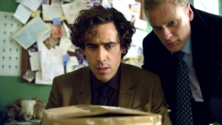 Dirk Gently (Stephen Mangan) and Richard MacDuff (Darren Boyd) ponder the nature of an unexpected parcel in Episode 1.