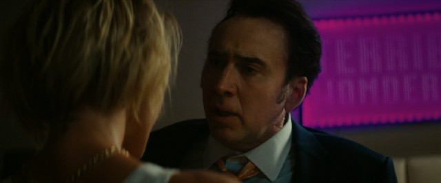 "Troy (Nicolas Cage) tells a prostitute about Nice, France in ""Dog Eat Dog."""