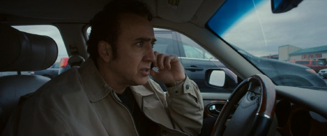 Troy (Nicolas Cage) makes a phone call from the parking lot of Apples, where some things with the police go down.