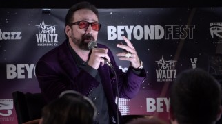 No, that's not Prince. It's Nicolas Cage in tinted sunglasses and a purple dress jacket answering questions at Beyond Fest.