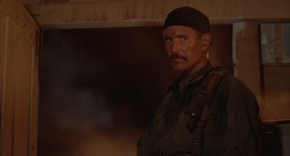 As the mustachioed Drew Blakeley, Tom Berenger makes a fatal mistake in the film's West African climax.