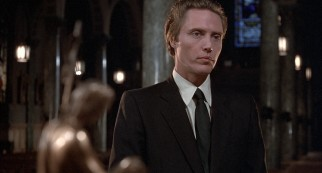 Jamie (Christopher Walken) attends an infant's Baptism in a scene exclusive to the extended international cut of the film.