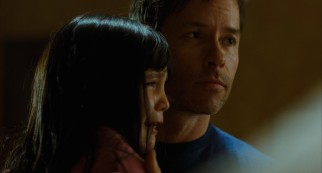 The arms of her loving father (Guy Pearce) are not enough to put Sally (Bailee Madison) at ease.