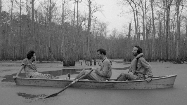 Escaped from jail, Zack (Tom Waits), Jack (John Lurie), and Roberto (Roberto Benigni) make use of a vacant canoe to find safety.