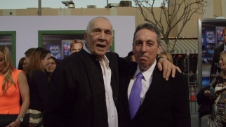 A Kevin Costner cardboard standee photobombs Frank Langella and director Ivan Reitman at the Draft Day premiere.