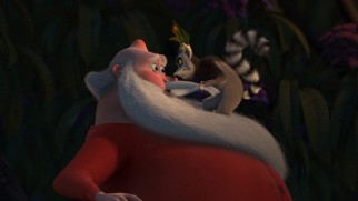 "A bothered King Julien pulls Santa Claus by the mustache in ""Merry Madagascar."""