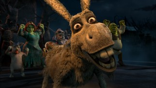 "In ""Thriller"", Donkey leads living and dead Shrek characters in the zombie dance from Michael Jackson's music video."