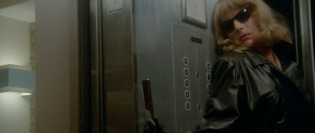 A mysterious blonde woman in sunglasses clings to a straight razor in an elevator where she's just committed murder.