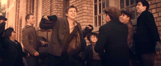 Morris Cohen (Michael Cera) does some celebratory dancing following the newsboy strike of 1899.