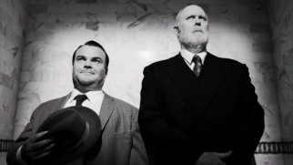 "Orson Welles (Jack Black) and the inspiration for Citizen Kane, William Randolph Hearst (John Lithgow), share an awkward elevator ride together in the Hollywood episode of ""Drunk History."""
