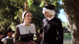 "Mary Dyer (Winona Ryder) stands up against religious intolerance from Puritans (Michael Cera) in ""Boston."""
