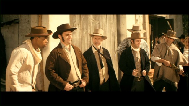 "William B. Travis (Jake Johnson), Jim Bowie (Chris Parnell), and Davy Crockett (Derek Waters) defend the Alamo against Santa Ana in ""The Wild West."""