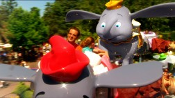 A CG-animated Dumbo flies up behind a father and daughter taking his ride of passage in a short piece on the popular Fantasyland attraction.