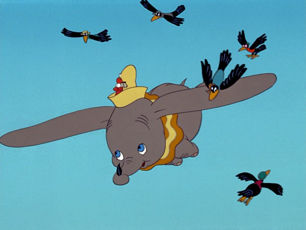 Dumbo flies with an underdefined Timothy Mouse and the black crows.
