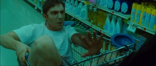 Undead assistant Marcus (Sam Huntington), a Groucho Marx double in the comic books, looks at his new replacement arm.