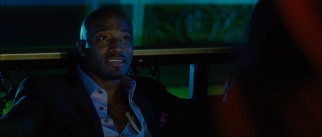 Powerful vampire club owner Vargas (Taye Diggs) shows attitude as he chats with Dylan.
