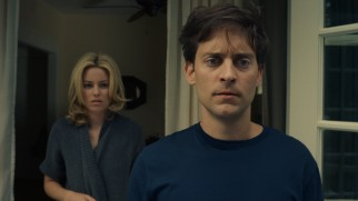 Nealy (Elizabeth Banks) and Jeff Lang (Tobey Maguire) awaken to find their lawn's sod torn up by raccoons.