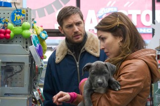 Nadia (Noomi Rapace) helps Bob (Tom Hardy) get what he needs to take care of his new rescued puppy Rocco.